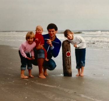 My dad, two older sisters, and me. Circa 1986